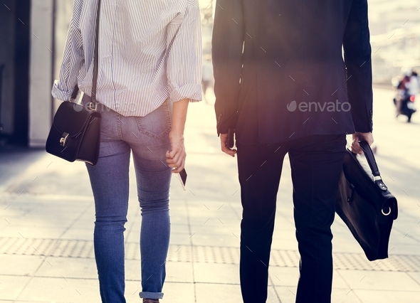 Couple walking on the pavement - Stock Photo - Images