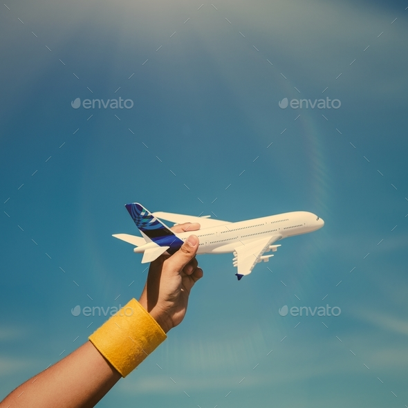 Kid playing with a toy airplane - Stock Photo - Images