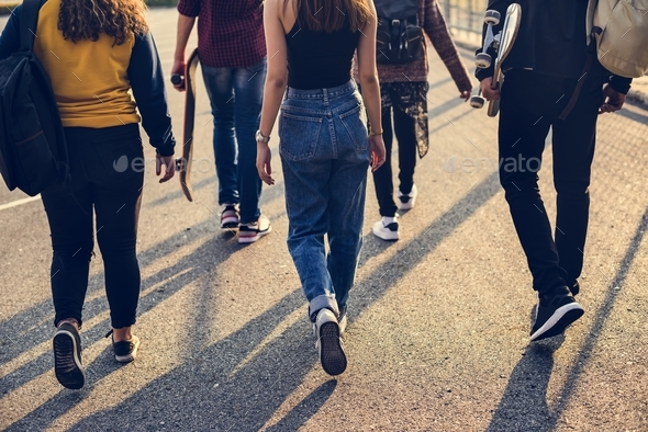 Rear view of group of school friends walking outdoors lifestyle - Stock Photo - Images