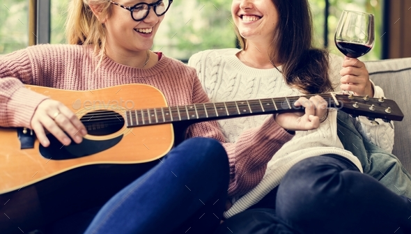 Women enjoying the music together - Stock Photo - Images