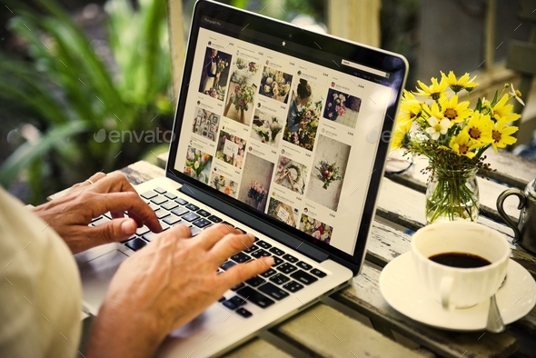 Woman is using computer laptop - Stock Photo - Images