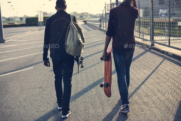 Teenager boy with a skateboard - Stock Photo - Images