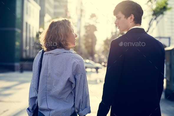 Couple walking on downtown together - Stock Photo - Images