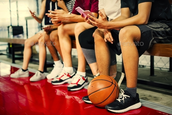 Group of young teenager friends on a basketball court relaxing u - Stock Photo - Images