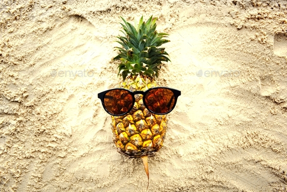 A pineapple with sunglasses - Stock Photo - Images