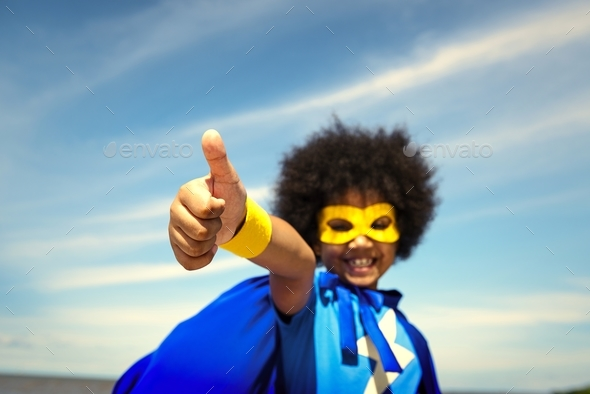 Cute little superhero girl with afro - Stock Photo - Images