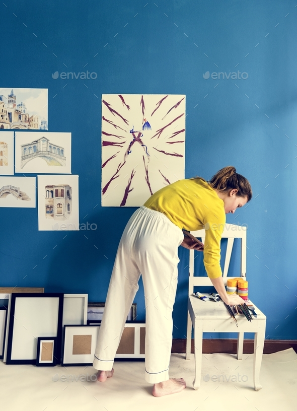 Young artist girl creaiting an artwork - Stock Photo - Images