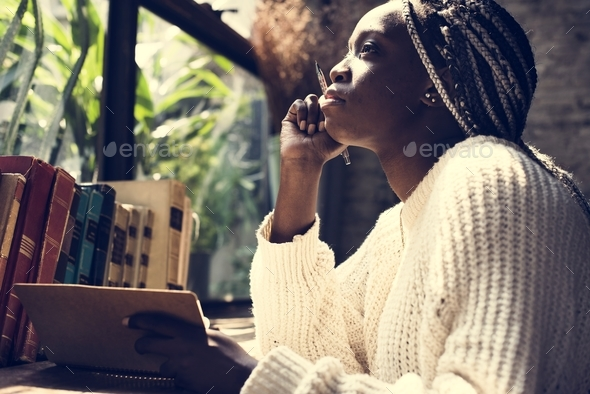 Portrait of black woman with dreadlocks hair - Stock Photo - Images