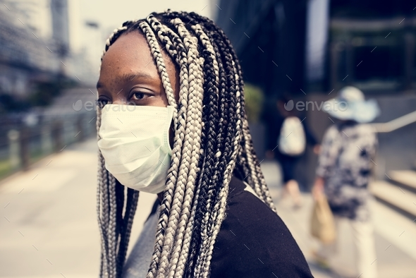 Portrait of black woman wearing mask - Stock Photo - Images