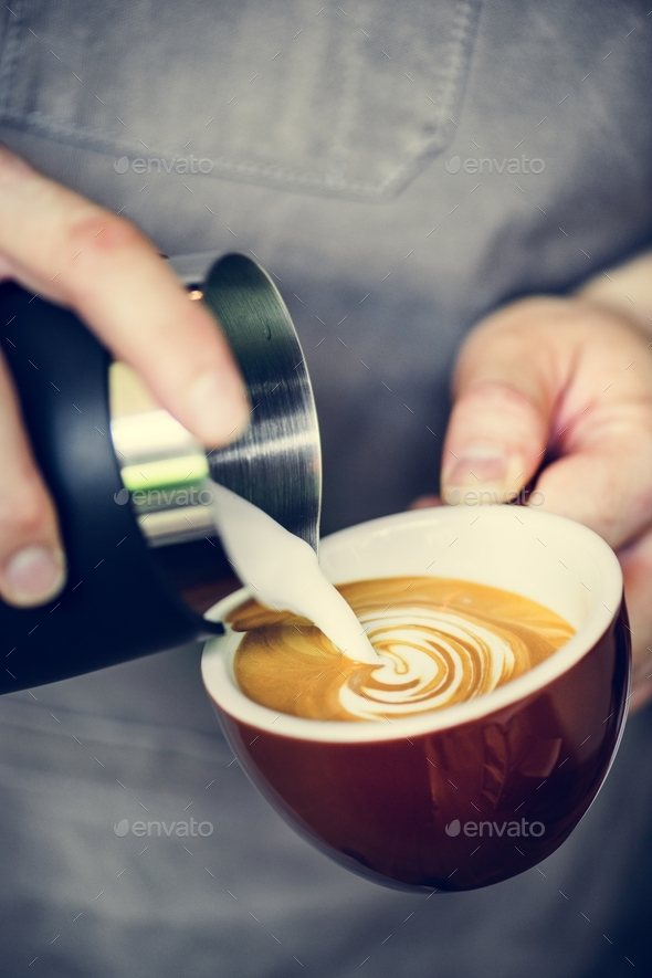 Closeup of barista making latte art - Stock Photo - Images