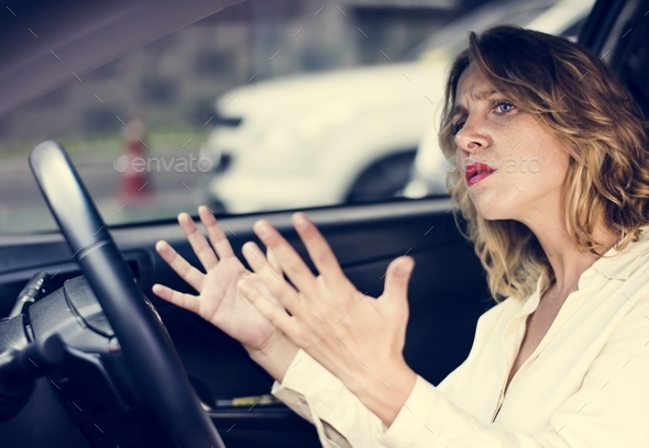 Frustrated woman stuck in traffic - Stock Photo - Images