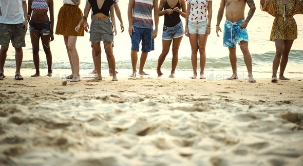 Group of diverse friends at the beach together - Stock Photo - Images