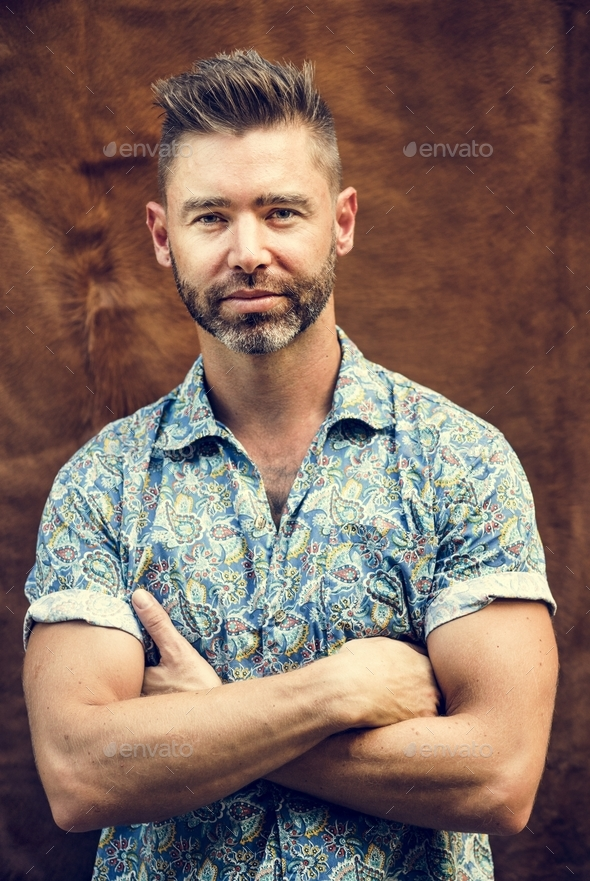 Portrait of caucasian man with arms crossed - Stock Photo - Images