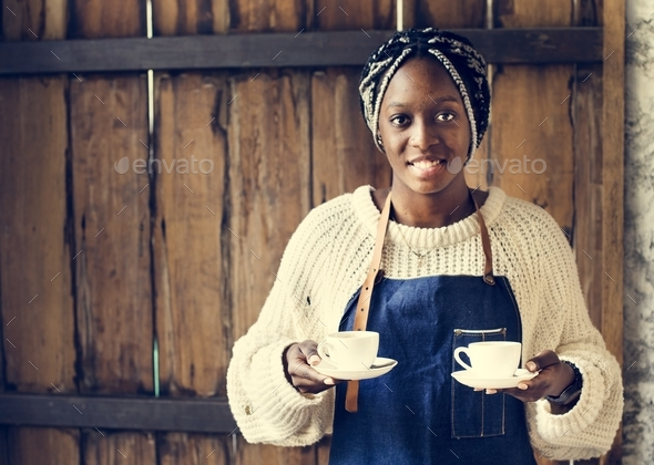 A barista serving coffee - Stock Photo - Images