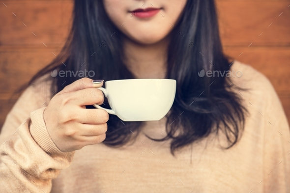 Woman enjoying coffee on the weekend - Stock Photo - Images