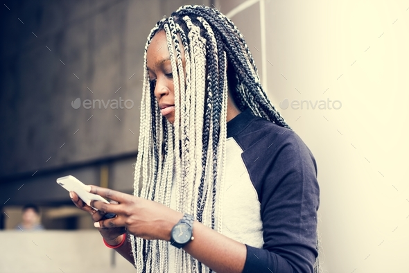 African woman using smartphone - Stock Photo - Images
