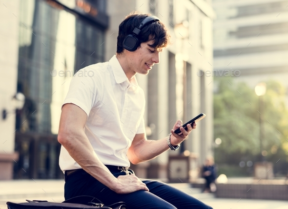 Casual man listening to music - Stock Photo - Images