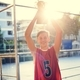 Caucasian teenage boy in sporty clothes holding up a trophy outdoors - PhotoDune Item for Sale