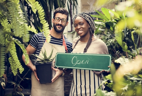 "People holding an ""open"" sign - Stock Photo - Images"