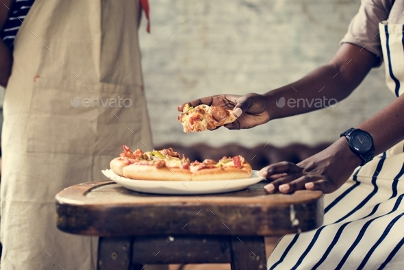 Couple eating pizza together - Stock Photo - Images