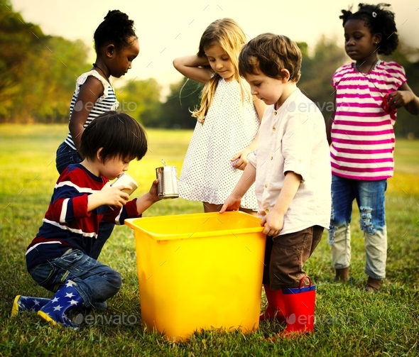 Responsible group of kids cleaning at the park - Stock Photo - Images