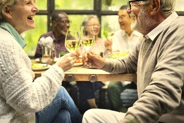 Group of happy retired seniors meet up in a restaurant - Stock Photo - Images