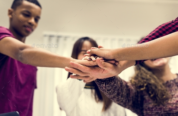 Study group classmates joining hands together teamwork concept - Stock Photo - Images