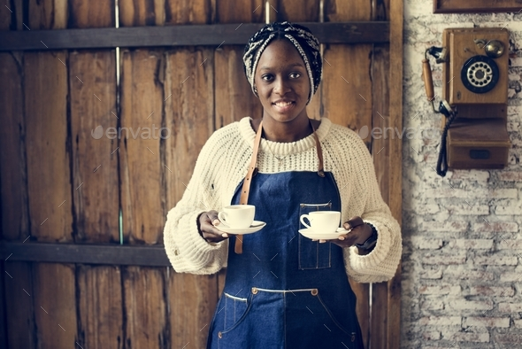 Black woman serving coffee - Stock Photo - Images