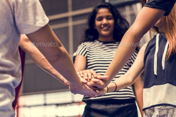 Group of teenager friends on a basketball court teamwork and togetherness concept - Stock Photo - Images