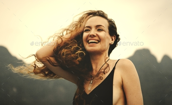Blond woman enjoying the summer breeze - Stock Photo - Images