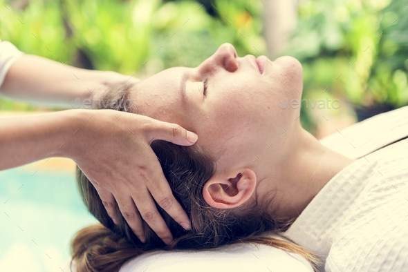 Caucasian woman relaxing with spa message - Stock Photo - Images