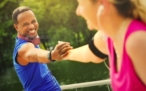 Playful interracial couple happy together in a park - Stock Photo - Images