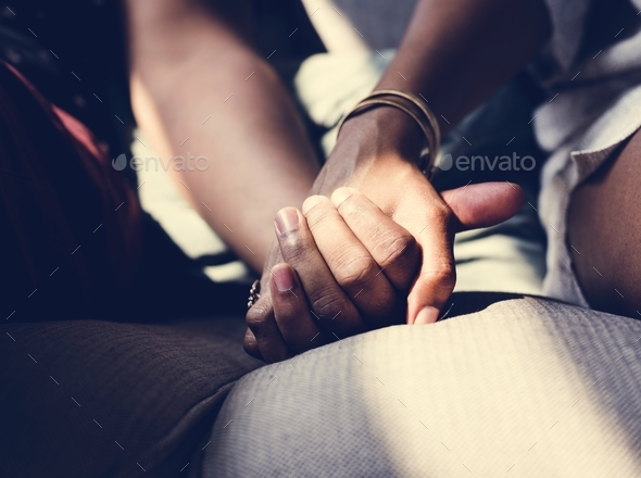 Closeup of couple holding hands - Stock Photo - Images