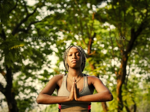 A woman doing yoga in the park - Stock Photo - Images