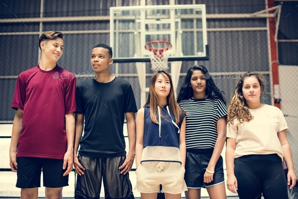 Group of young teenager friends on a basketball court standing in a row - Stock Photo - Images