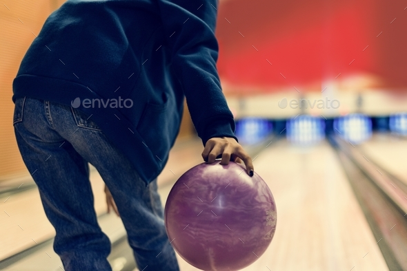 Grabbing the pink bowling ball - Stock Photo - Images