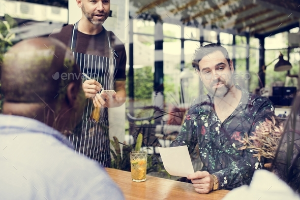 Group of diverse people in the restaurant - Stock Photo - Images