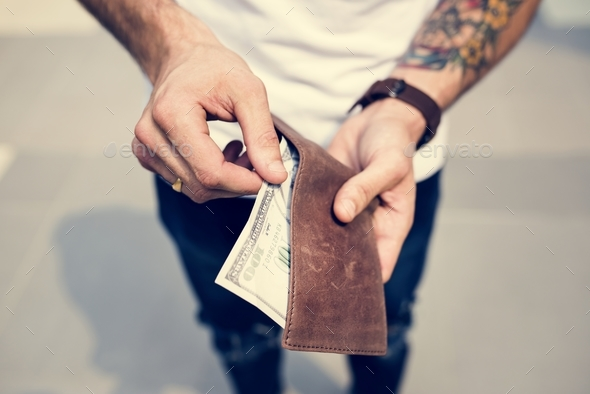 Dollar bill in a wallet - Stock Photo - Images