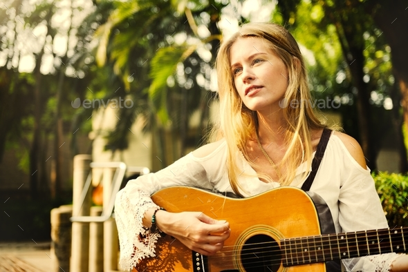 Beautiful singer songwriter with her guitar - Stock Photo - Images
