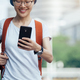 Asian woman use mobile phone on city street - PhotoDune Item for Sale
