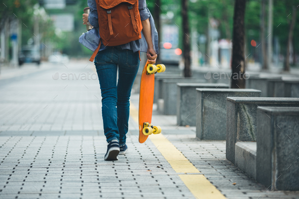 Woman with skateboard on city - Stock Photo - Images
