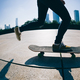 Skateboarder legs skateboarding at sunrise city - PhotoDune Item for Sale