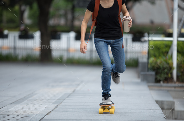 Skateboarder skateboarding at city - Stock Photo - Images