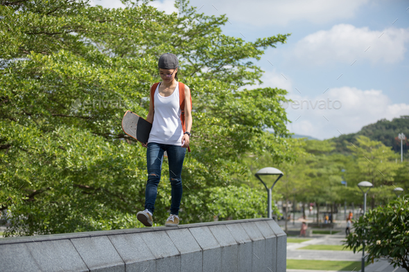 Walking on the city building edge - Stock Photo - Images