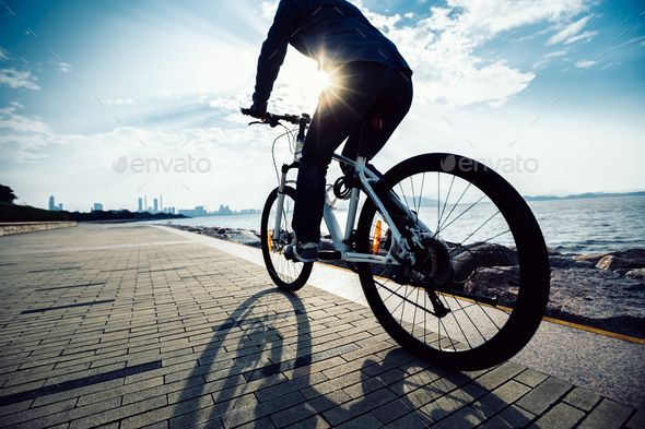 Cycling in the morning coast - Stock Photo - Images