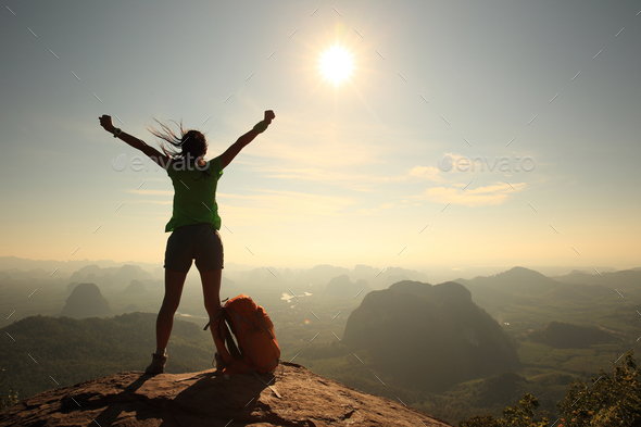 Cheering for see the first sight sunshine on mountain top  - Stock Photo - Images