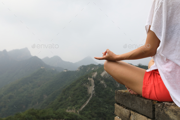 Yoga on top of great wall - Stock Photo - Images