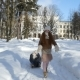Ginger-Haired Little Girl Walking on Winter Park at Sunny Day and Sledding Her Toy - VideoHive Item for Sale