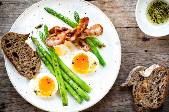Bacon,Seared Asparagus and Soft boiled egg with Rye bread - Stock Photo - Images