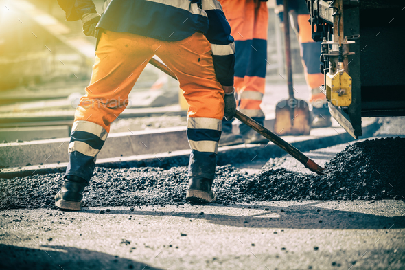 Teamwork on road construction - Stock Photo - Images